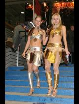 """Photo of publication """"Katya and Tanya"""", author Kostya Romantikov, Tags: [exhibitions, IgroMir, pantyhose (tights) skin color, High slit, short skirt (miniskirt), Catherine (Kate) Berezina, sandals, heels, exhibitions in 2006, events]"""