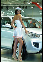 """Photo of publication """"SIA ` 2012. Julia."""", author Эдуард@fotovzglyad, Tags: [exhibitions, Kyiv International SIA Motor Show, Ukraine, Kiev, exhibitions in 2012, bare legs, white dress, short dress, sandals, events, car, Chery girls, high arched feet]"""