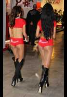 """Photo of publication """"Milan Bikeshow 2012 - Part 35"""", author Bootsman, Tags: [exhibitions, pantyhose (tights) skin color, black boots, exhibitions in 2012, Italy, Milan, Milan Bike Show, boots knee, events, pantyhose (tights) sheer, transparent, car show, bikeshow]"""