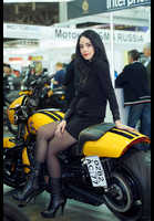 """Photo of publication """"Motopark-12. Black mini"""", author Эдуард@fotovzglyad, Tags: [exhibitions, Motor Park, exhibitions in 2012, events, black tights (pantyhose), black dress, short dress, motorcycle (bike), sitting leg to leg, sitting sideways on a motorcycle]"""