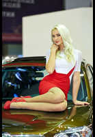 """Photo of publication """"MIAS -14. Julia."""", author Эдуард@fotovzglyad, Tags: [exhibitions, exhibitions in 2014, pantyhose (tights) skin color, heels, Moscow International Motor Show, shoes red, car, blonde, red skirt, Julia Korf, events, sitting on the hood, car show]"""