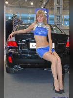 """photo from the publication """"Sasha at the exhibition 4WD Salon"""", author Владимир, Tags: [exhibitions, pantyhose (tights) skin color, shoes black, heels, car, , blonde, blonde, the skirt is very short, events of 2007, Alexandra (Sasha) Kravchenko, long legs, events, pantyhose (tights) sheer, transparent, car show]"""