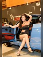 """photo from the publication """"Seoul Auto Salon 2018"""", author KRWonders, Tags: [exhibitions, pantyhose (tights) skin color, shoes black, car, brunette, black dress, asian, sitting legs crossed, dress very short (mini-dress), high heels, dress fitting, tight, slinky, events, pantyhose (tights) sheer, transparent, car show, events of 2018, Korea, Seoul]"""