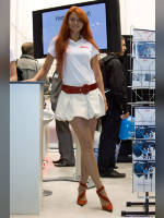 """photo from the publication """"InfoKom'2008 - Catherine at booth APC"""", author Эдуард@fotovzglyad, Tags: [exhibitions, pantyhose (tights) skin color, dress white, standing cross-legged, events of 2008, pantyhose (tights) with glitter, redhead, InfoCom, Catherine (Kate) Egorova, dress very short (mini-dress), high heels, events, pantyhose (tights) sheer, transparent, stiletto heels]"""