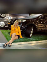 """photo from the publication """"Moscow motor show 2008 - Alexandra at the stand of Continental"""", author Эдуард@fotovzglyad, Tags: [exhibitions, pantyhose (tights) skin color, cleavage, Moscow International Motor Show, blonde, events of 2008, short skirt (miniskirt), Alexandra (Sasha) Goyarchuk, events, pantyhose (tights) sheer, transparent, yellow blouse, Audi girls, car show]"""