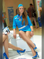 """photo from the publication """"COMMUNICATION EXPOCOMM 12. MTS - 2."""", author Эдуард@fotovzglyad, Tags: [exhibitions, pantyhose (tights) skin color, short dress, heels, dress light-blue, events of 2012, Moscow, Russia, forage-cap, white panties, pantyhose (tights) with glitter, CSTB, stewardess, flight attendant, shoes blue, sitting legs crossed, events]"""