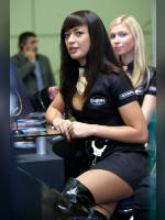 """photo from the publication """"ProdExpo'2009 - girls stand vodka """"Kazenka"""""""", author Эдуард@fotovzglyad, Tags: [exhibitions, short dress, heels, cleavage, black boots, stocking tops visible, Prodexpo, black dress, events of 2009, stockings, skin-color, events, Girl Kazёnka]"""
