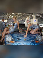 """photo from the publication """"Moscow Motor Show 2008 - Eugene with girlfriend"""", author Эдуард@fotovzglyad, Tags: [exhibitions, pantyhose (tights) skin color, Moscow International Motor Show, car, events of 2008, naked legs, events, girls Pioneer, car show]"""