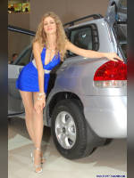 """photo from the publication """"Kate on the stand Hyundai"""", author Владимир, Tags: [exhibitions, pantyhose (tights) skin color, cleavage, dress light-blue, car, Interauto and MIMS, blonde, events of 2007, events, girls Hyundai, polished nails, manicure, red lips, pantyhose (tights) sheer, transparent, car show]"""