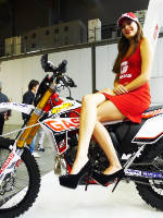 """photo from the publication """"EICMA 2012"""", author Andrea Gianotti, Tags: [exhibitions, short dress, shoes black, red dress, Italy, Milan, sitting legs crossed, high heels, events, sitting sideways on a motorcycle, , , Europe]"""