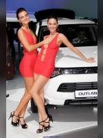 """photo from the publication """"MMAS-12. Stand Mitsibishi."""", author BetsaSerg, Tags: [exhibitions, short dress, shoes black, heels, Moscow International Motor Show, events of 2012, red dress, car, sandals, events, Mitsubishi girls, car show]"""