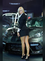 """photo from the publication """"MMAS-12. Mansory. Marina."""", author Эдуард@fotovzglyad, Tags: [exhibitions, short dress, Moscow International Motor Show, events of 2012, standing cross-legged, blonde, black dress, black skirt, naked legs, short skirt (miniskirt), Marina Lobazhnikova, events, high arched feet, car show]"""