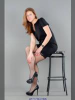"photo from the publication ""Anya Borisenko, a girl in the dark"", author Kostya Romantikov, Tags: [short dress, shoes black, heels, stocking tops visible, stockings fishnet black, black dress, Staged photography, Anna (Anya) Bo, in the studio, sitting legs crossed]"