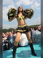"""photo from the publication """"Goldfire Cheerleader"""", author Serge Pellkatov, Tags: [events of 2014, pantyhose (tights) skin color, heels, boots below the knee, black boots, the skirt is very short, outdoor, dancing, Germany, events, pantyhose (tights) sheer, transparent, cheerleaders, halter (cut-off) top, tight boots, Europe]"""