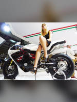 """photo from the publication """"EICMA 2012"""", author Andrea Gianotti, Tags: [exhibitions, short dress, shoes black, Italy, blonde, black dress, Milan, naked legs, high heels, events, sitting sideways on a motorcycle, , , Europe]"""