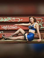 """photo from the publication """"Alisha, pinup"""", author Eric D., Tags: [stocking tops visible, stockings black, the skirt is very short, skirt blue, Staged photography, lifting leg, skirt fitting, tight, slinky, bra blue]"""