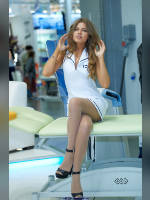 """photo from the publication """"INTERCHARM- 12. Irina."""", author Эдуард@fotovzglyad, Tags: [exhibitions, pantyhose (tights) skin color, shoes black, heels, dress white, events of 2012, Intercharm, sitting legs crossed, dress very short (mini-dress), shoes with an open toe, sitting, events]"""