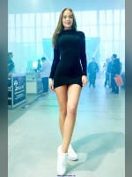"""photo from the publication """"VAPEXPO-2017 Summer Moscow Ilona"""", author Эдуард@fotovzglyad, Tags: [exhibitions, standing cross-legged, black dress, sneakers, naked legs, dress very short (mini-dress), dress fitting, tight, slinky, events, , events of 2017, Ilona Halyavina]"""