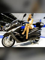 """photo from the publication """"EICMA 2012"""", author Andrea Gianotti, Tags: [exhibitions, short dress, shoes black, dress white, Italy, blonde, Milan, sitting legs crossed, high heels, events, sitting sideways on a motorcycle, , , Europe]"""