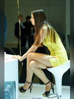 """photo from the publication """"PhotoForum-14. NIKON. Anya."""", author Эдуард@fotovzglyad, Tags: [exhibitions, events of 2014, pantyhose (tights) skin color, shoes black, heels, brunette, sandals, PhotoForum, pantyhose (tights) with glitter, yellow dress, sitting legs crossed, long legs, dress very short (mini-dress), events, girls Nikon, pantyhose (tights) sheer, transparent]"""