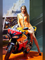 """photo from the publication """"Moto Park 15. REPSOL."""", author Эдуард@fotovzglyad, Tags: [exhibitions, motorcycle (bike), pantyhose (tights) skin color, shoes black, Motor Park, yellow dress, dress very short (mini-dress), high heels, dress fitting, tight, slinky, events, pantyhose (tights) sheer, transparent, sitting sideways on a motorcycle, events of 2015, car show]"""