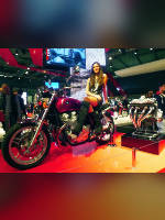 """photo from the publication """"EICMA 2012"""", author Andrea Gianotti, Tags: [exhibitions, short dress, boots below the knee, black boots, Italy, fishnet pantyhose (tights) skin color, black dress, Milan, sitting legs crossed, high heels, events, sitting sideways on a motorcycle, , , Europe]"""