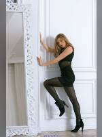 """photo from the publication """"Valya in the Studio (5)"""", author Kostya Romantikov, Tags: [pantyhose (tights) black, shoes black, blonde, black dress, Staged photography, in the studio, lifting leg, dress very short (mini-dress), high heels, dress fitting, tight, slinky]"""